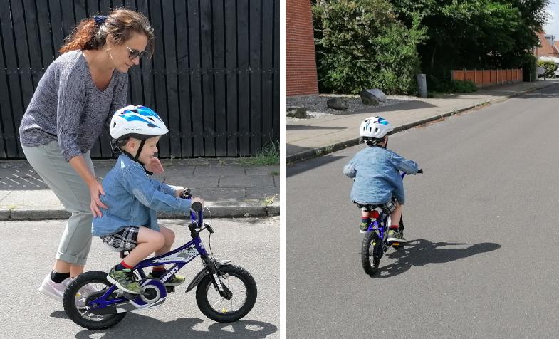 Billede af kvinde som lærer dreng at cykle